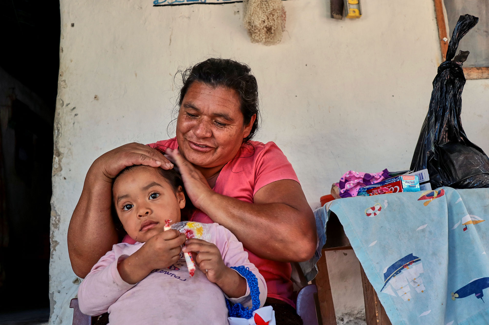 a woman and her child in honduras during a visit from alive to love missionaries
